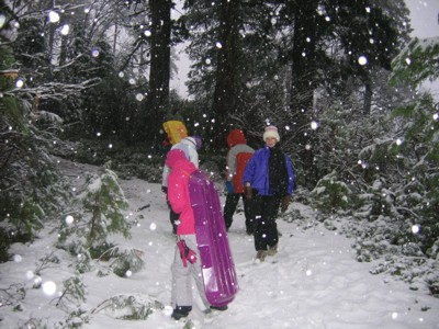 kids playing in falling snow