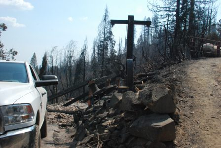Image of a burned hillside with two roads leading up and down