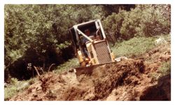 Image of a bulldozer on the hillside