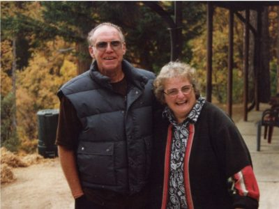 Image of the happy owners with the garage walkway in the background