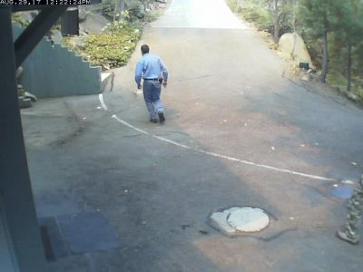 Webcam image of neighbor running to the front door