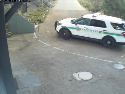 Image of Sheriff's cruiser driving past the Trestlewood Chalet
