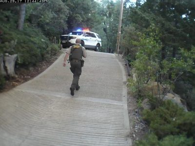 Image of officer leaving the house quickly