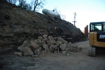 Image of a pile of large boulder-size rocks and concrete chunks