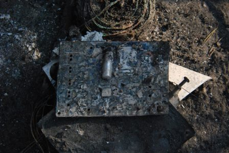 Image of a burned circuit board still holding a few components