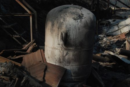 Image of a water tank with a gash in the sidewall
