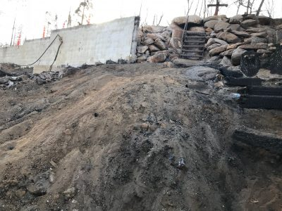 Image of bare dirt below the exposed foundation wall