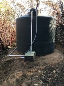 Image of a new 2500 gallon water tank and plumbing