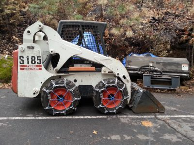 Image of Bobcat with tire chains installed