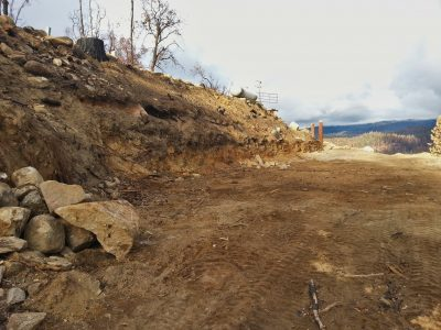 Image of the cleared building site, now without woodpiles