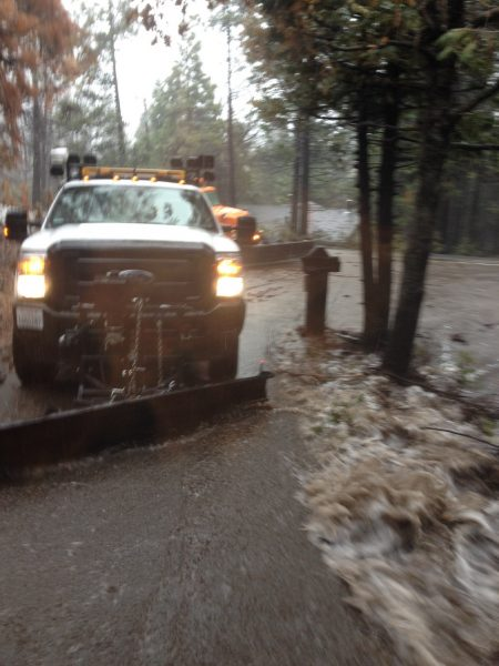 Image of a Caltrans truck surrounded by whitewater