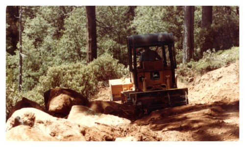 Image of a bulldozer and large rocks